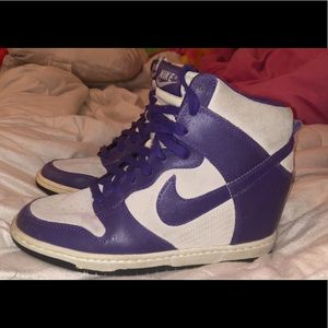 Purple Nike wedges.